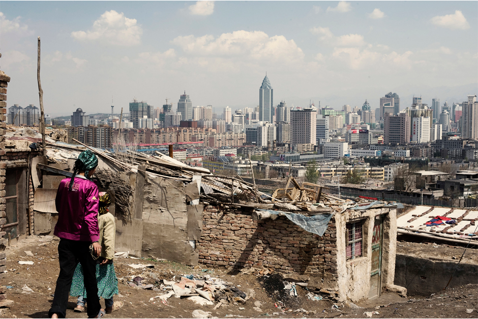 The slums of Urumqi stand a world away from the high-rises that make up the skyline of Xinjiang's provincial capital. Many Uighurs who migrated to the urban center of Xinjiang live in these slums, and government officials pinned the July 2009 riots on members of this community. The slums have largely been demolished since this photo was taken in 2010, to make room for a high-speed train linking Urumqi to the rest of China.