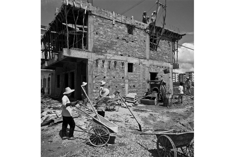 Communal home construction for workers outside a factory in Kengzi, Guangdong province, 1999.