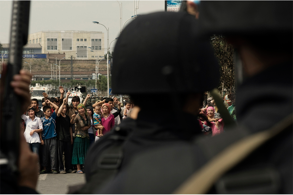 Two days after an episode of interethnic violence in July 2009, a group of Uighur demonstrators in Urumqi, mostly women, confronts the police, demanding information about the disappearance of their husbands, brothers, and sons. According to Human Rights Watch, in the days following the riots, dozens of Uighur men and teenagers were detained by police and have not been heard of since.