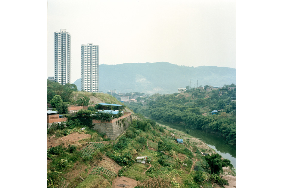 In the Jiangbei district of Chongqing, just downstream of where the Jialing River joins the Yangtze, the city is pushing for more urban development. Farmers, relocated to the city due to the construction of the Three Gorges Dam hundreds of miles downriver, seek cultivable land on hillsides and active construction sites.