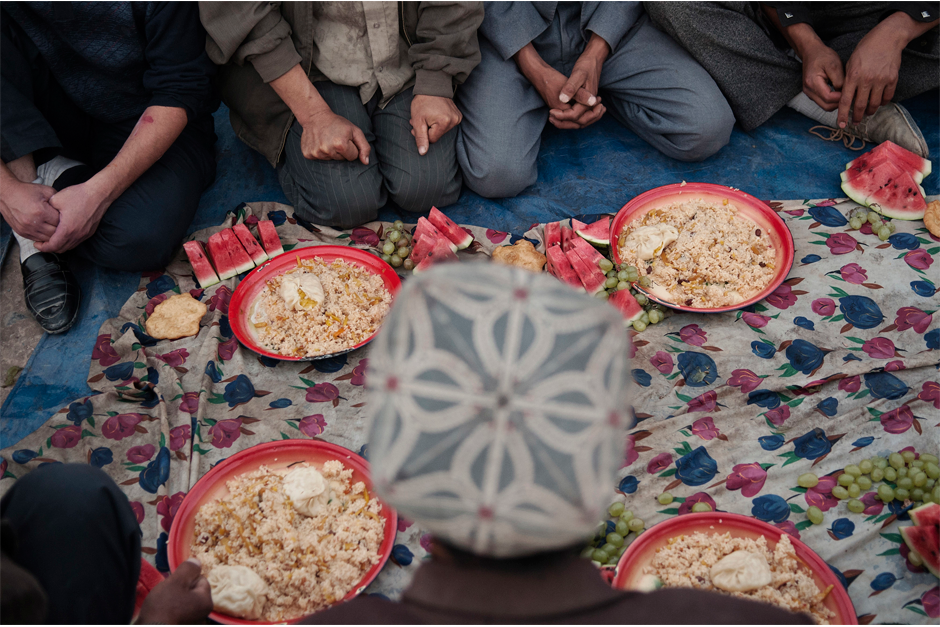 In Kashgar, Uighurs pause before breaking the fast during the holy month of Ramadan. Throughout the Muslim world, food is customarily distributed to the needy during this holy month. However, this past holiday many in the Uighur community complained of religious repression imposed from Beijing. Among the rules in effect: it is forbidden to pray in public, apart from inside religious buildings. In addition, civil servants and people younger than 18 are banned from visiting mosques and from fasting during Ramadan.
