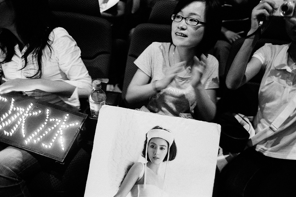 Young film fans holding posters of their favorite actress fill an auditorium before Bingbing's appearance at a test screening in Shanghai.