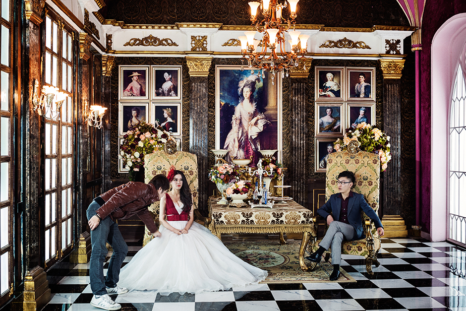 Cheng, twenty-eight, and her fiance Zhang, thirty-three, prepare for a shoot on the Versailles set at The Only Photo Studio. The basic package, costing 3,000 RMB, comes with six outfit changes and six setting choices.