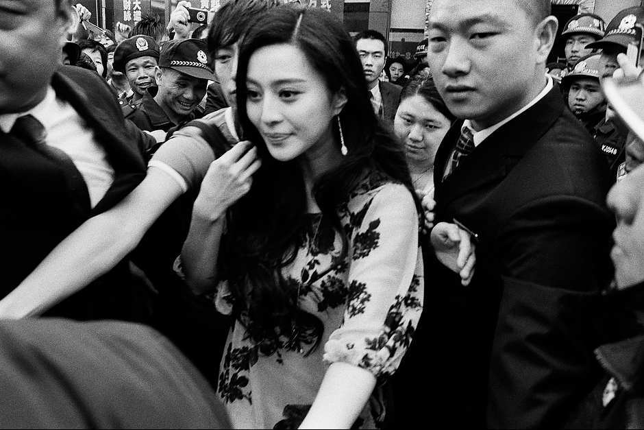 Bingbing and her assistants flee a fanatic crowd after a brief endorsement appearance for a shoe wholesaler in a Shenzhen suburb known for the production of women's shoes.