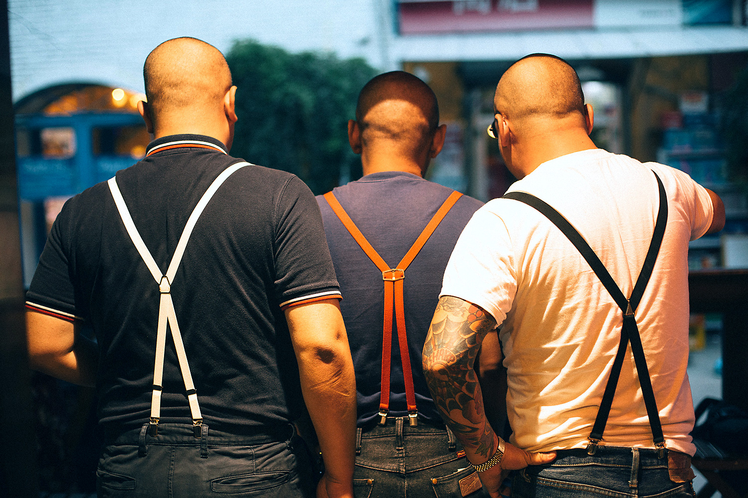 Thin suspenders, crossed at the back, are part of the standard punk attire.