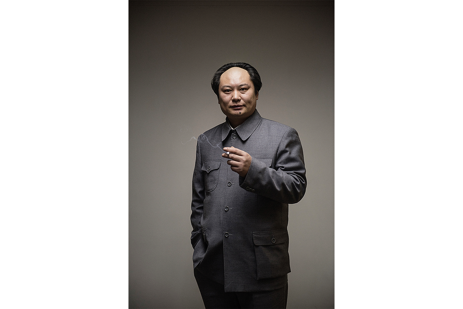 Mao impersonator Yang Chunlong poses for the photographer before a performance in Beijing. Photo by Matjaž Tančič @matjaztancic