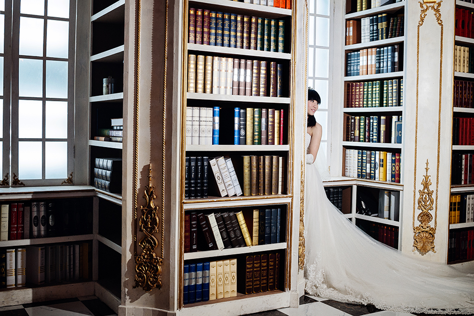 A bride-to-be poses in the library of The Only Photo Studio. The studio employs sixty photographers.