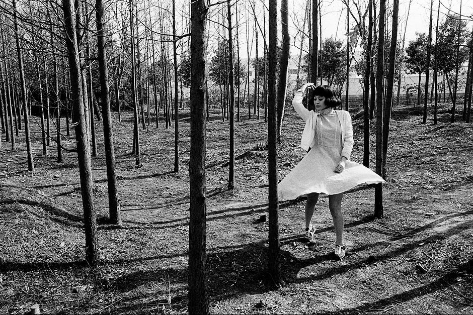 Bingbing dances playfully in a grove of trees between takes on the set of a TV soap opera in the Songjiang district of Shanghai.