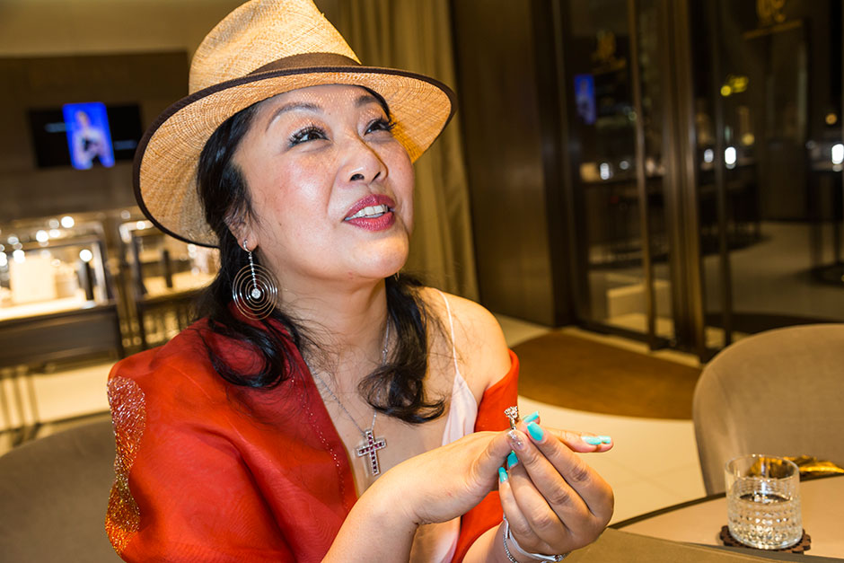 Yvonne Xue, 52, a Shanghai-based entrepreneur, tries on a diamond ring at her favorite jewelry store, the Italian-based Damiani.