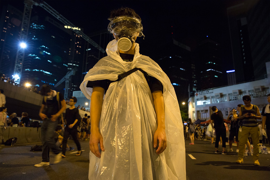 A pro-democracy protestor stands before a photographer in Hong Kong as thousands of others remain on the streets of the city after a weekend of protests. (Photo by Paula Bronstein/Getty Images)