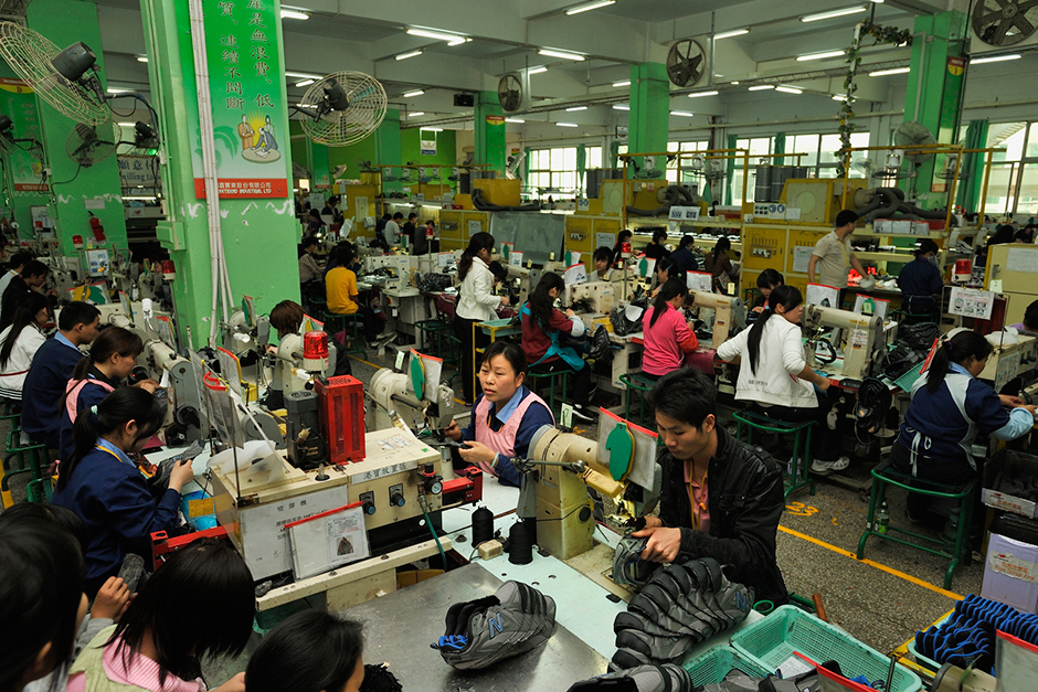 Zhao Meifang stitches uppers for New Balance shoes on the Freetrend factory assembly line.  She has worked there for four years and supports four children with her husband.