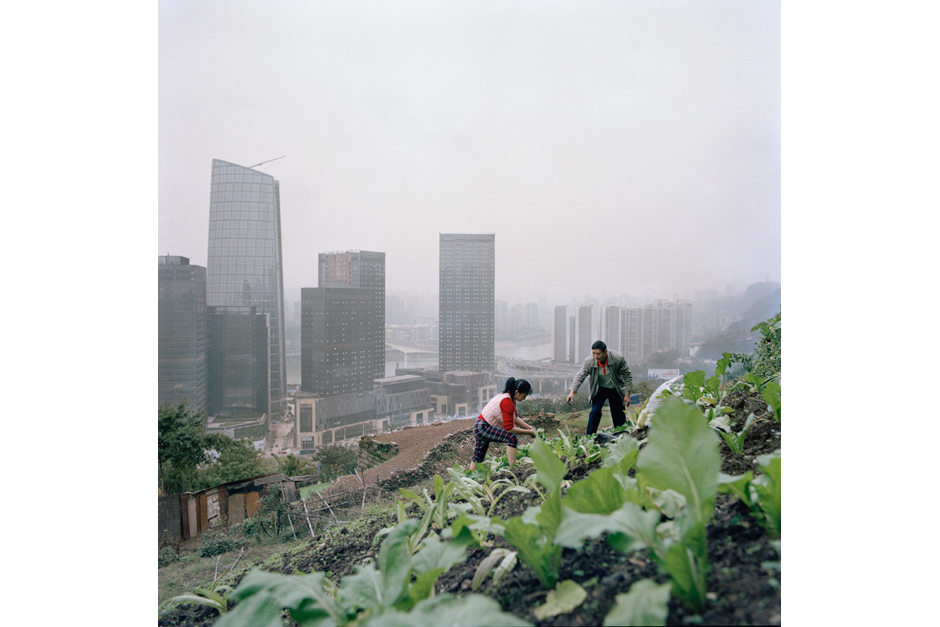 Huang Chunying and her husband work barefoot on a garden above the new business developments in the Tiandi district. Across the river from Jiangbei, a Hong Kong property developer is putting the finishing touches on a sleek modern development. There, residents and visitors who make up the emerging upper-middle class will be offered every modern-day convenience.
