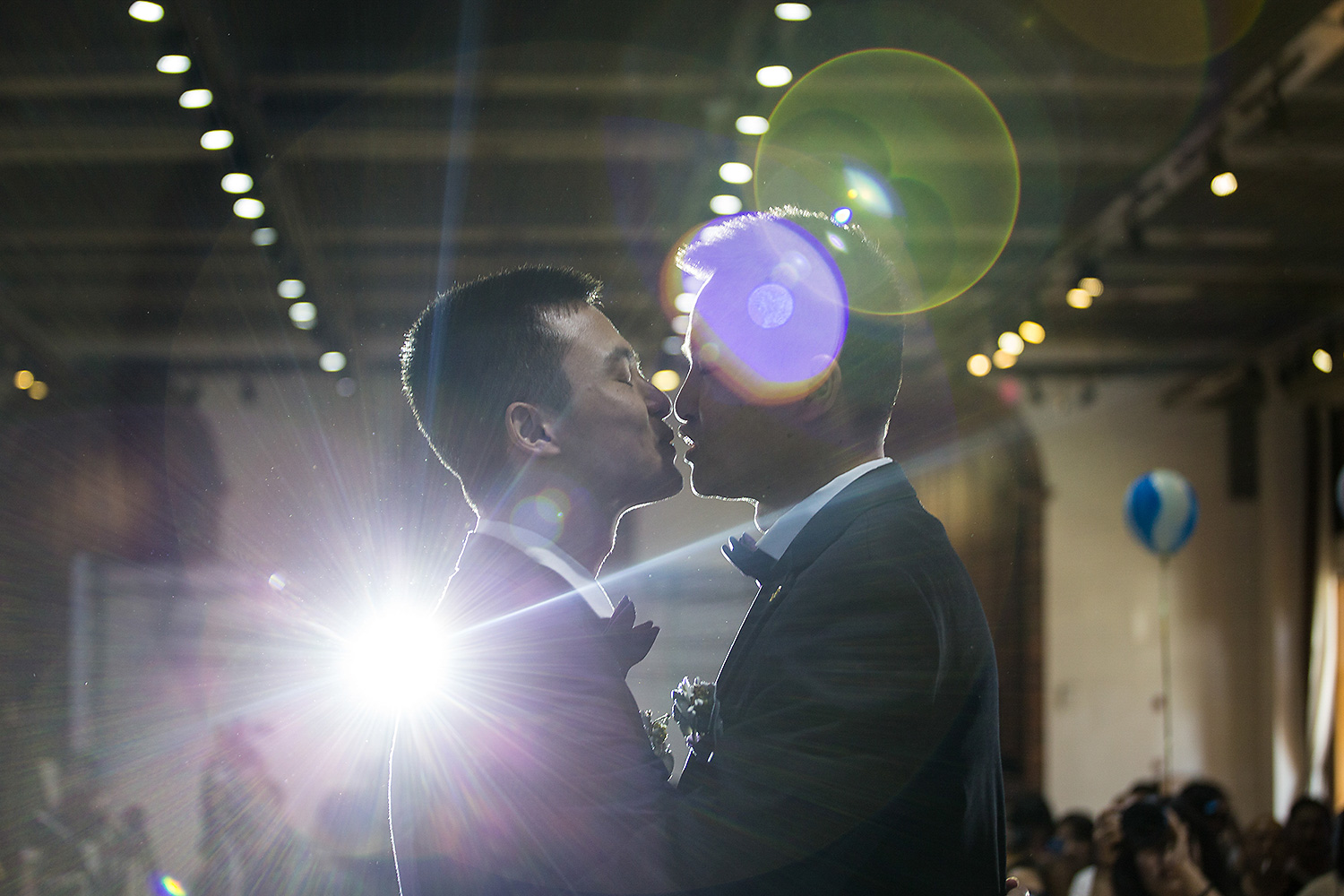Sun Wenlin and Hu Mingliang kiss during their illegal wedding ceremony in Changsha, Hunan province. Photo by Wu Yue @yuewoo