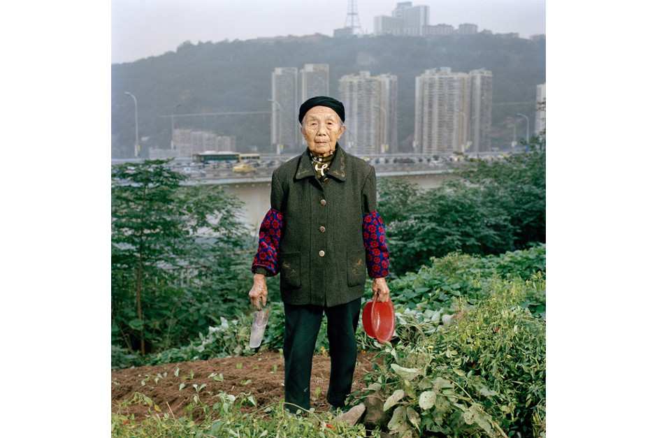 Zhong Baixin, eighty-seven, is cultivating a square meter of lettuce for her own table. She has lived all her life in Chongqing and now lives in what remains of a farming village stuck between a construction site and a road.