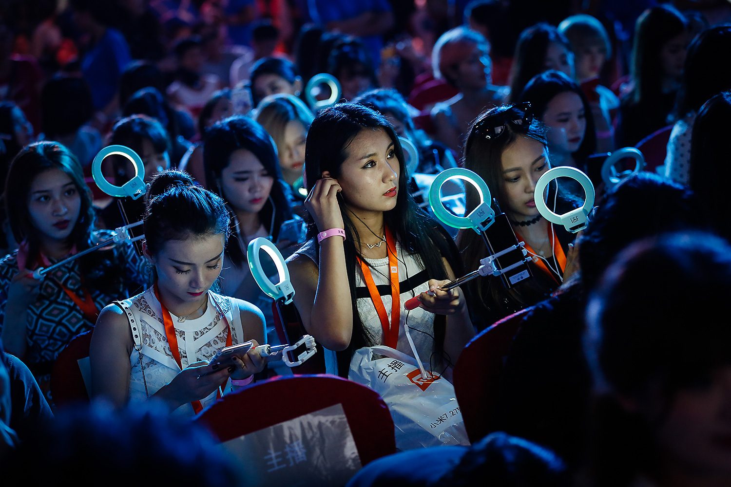 Aspiring Internet celebrities (a.k.a. hostesses) attend a product release presentation at a conference in Beijing. Every month, more than 85 million people watch live broadcasts on cellphone apps, according to QuestMobile. Photo by Liu Xingzhe @liuxingzhe