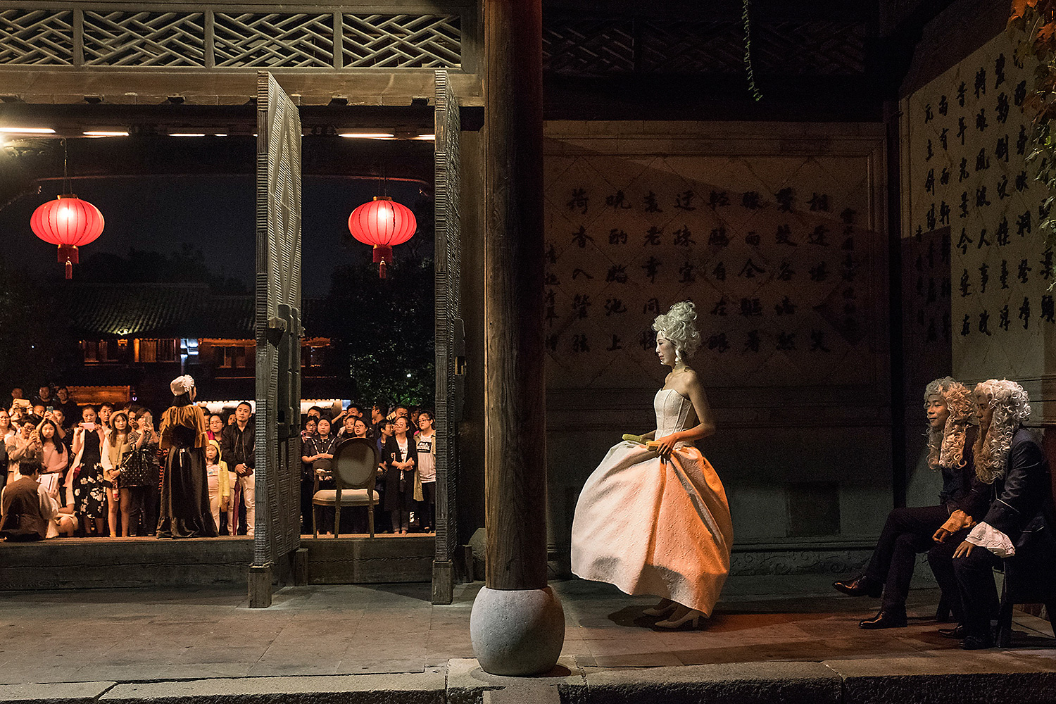"In a renovated building in Wuzhen, a historic town in Zhejiang province, actors wait backstage during a staging of Moliere's comedy ""The Learned Ladies."" The troupe performed during a city theater festival. Photo by Gilles Sabrié @gillessabrie"