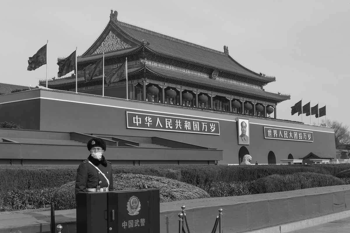 A People's Armed Police officer stands guard outside the entrance to the Forbidden City, in Tiananmen Square, January 24, 2020.