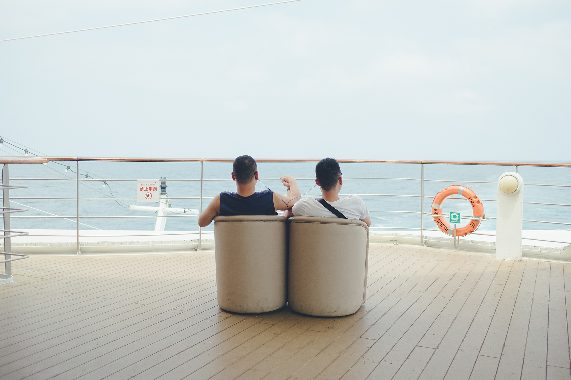 Lang and Chao relax on the deck, hand in hand, as the Glory Sea cruise sails between China and Japan, one day before the ship returns to Shanghai from its four-day journey, June 17, 2017. The couple, along with another 800 people, are here for a conference organized by PFLAG China, an annual event to help LGBTQ people and their families better understand and support one another. But more importantly, they are here for an LGBTQ group wedding ceremony.