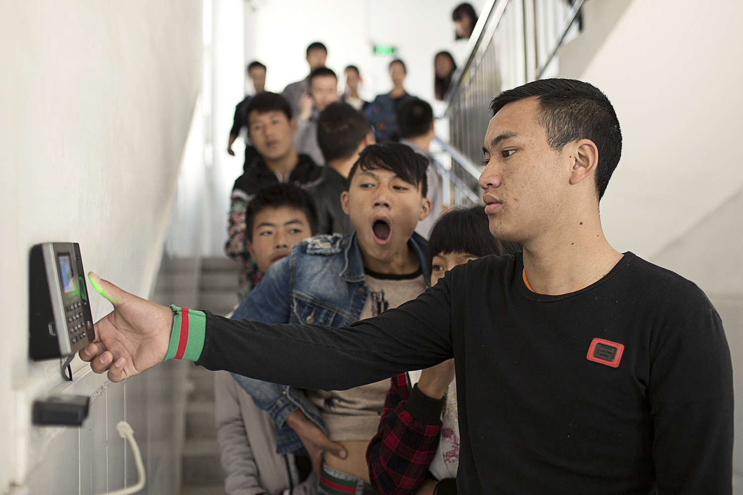 January 2, A Xia (front) and his coworkers, all members of the Yi minority from the Liangshan region of Sichuan, start their first day of work at an electronic device factory in Shenzhen. There are now an estimated 300,000 Yi workers in the Pearl River Delta. (Zhou Qiang)