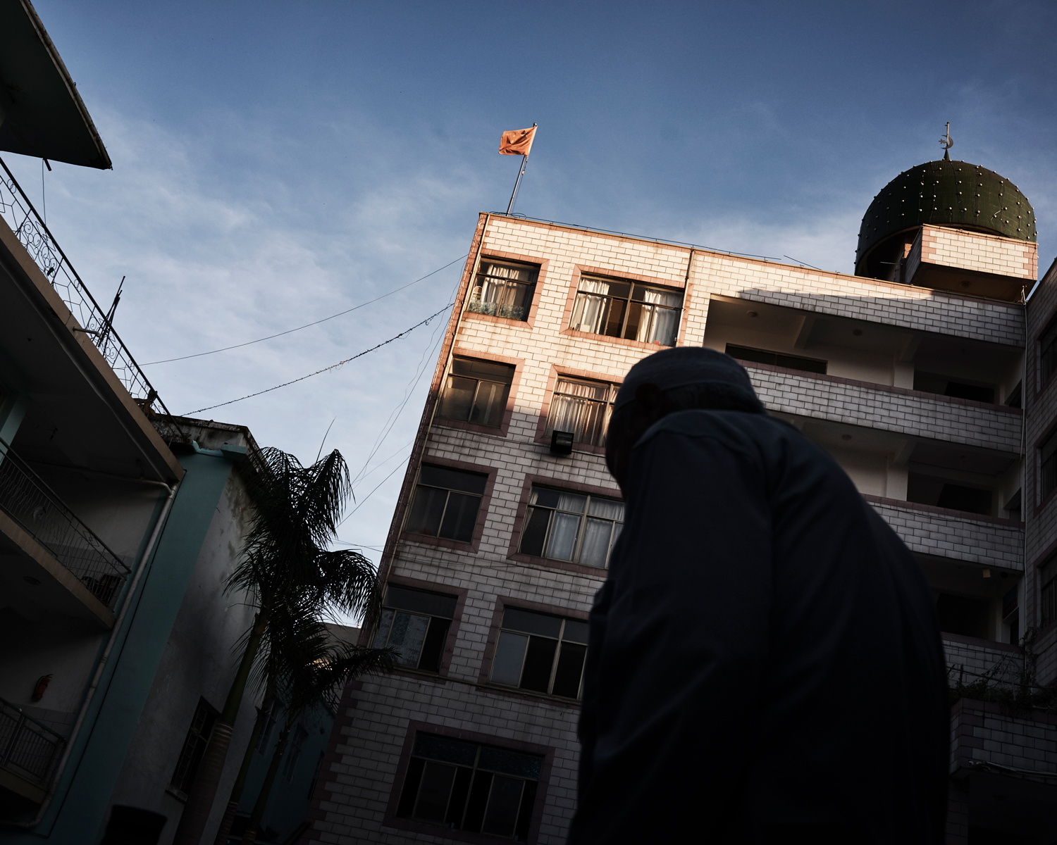 A People's Republic of China (P.R.C.) flag flies over Nanguan Mosque, in the city of Kaiyuan, China's southwestern Yunnan province, June 2016. Last year, state-sanctioned religious associations proposed that all religious venues in China should raise the P.R.C. flag.