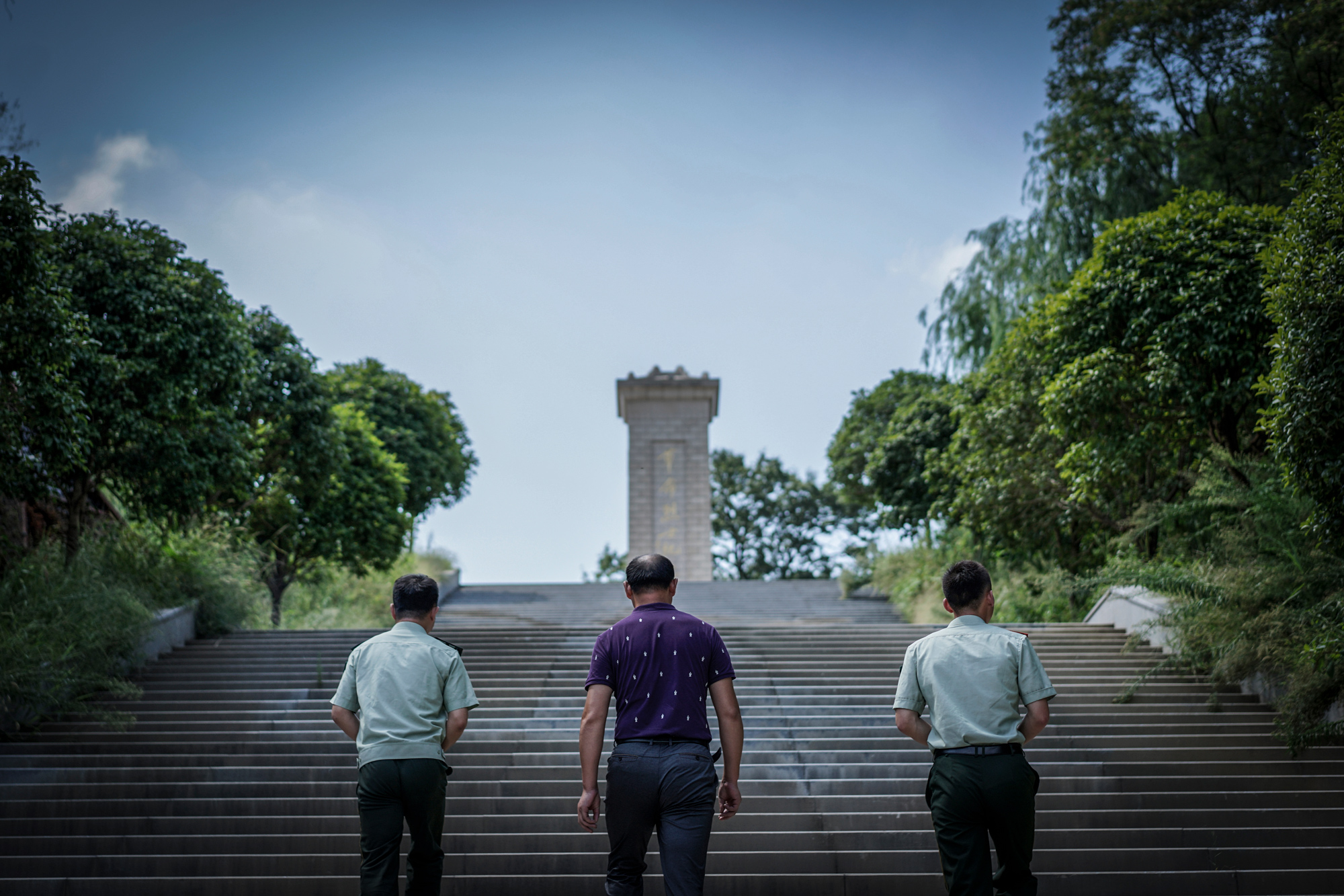 Most of the people who died in the August 12, 2015 Tianjin explosion were firefighters like Pang Ti. On August 10, 2017, two days before the second anniversary of Ti's death, his father, Pang Fangguo, and fellow firefighters visit his tomb at Martyrs' Cemetery in his hometown, Suizhou, in Hubei province.