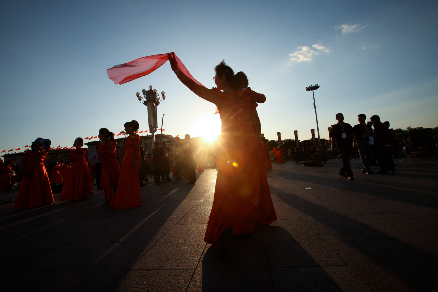 A group of female performers rehearse a routine one last time at sunset on National Day, October 1, 2009 in Tiananmen Square. National Day marks the founding of the People's Republic of China.