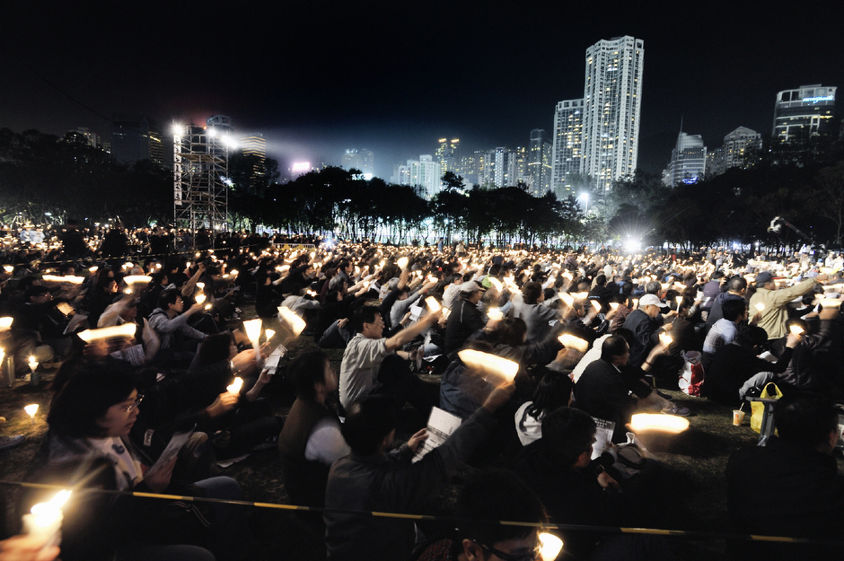 A candlelight memorial in Victoria Park, February 27, 2011, for democracy activist Szeto Wah, who died at the age of seventy-nine. Under China's one country, two systems policy, Hong Kong citizens enjoy free speech, but voting rights are limited.
