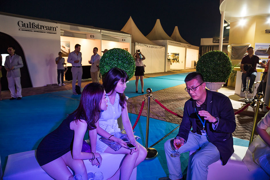 Party-goers chat during a cocktail gala at SO! Dalian, a boutique yachting event held in the port city, a potential new epicenter for an emerging yachting culture in Northern China.
