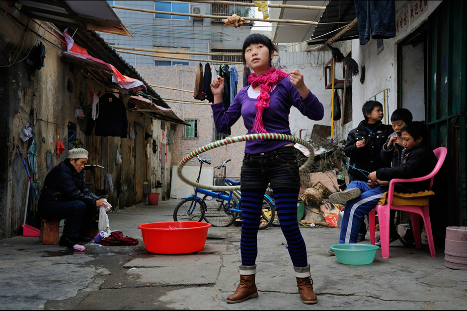 Zhao Meifang's daughter, Tan Yue, who was working at Freetrend New Balance plant at the time, hula hoops during the 2010 Lunar New Year holiday.  Since then she has moved to another shoe factory in Guangdong.