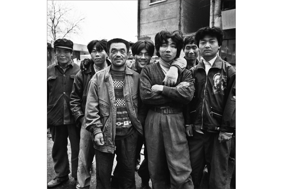 A group photo of factory workers.