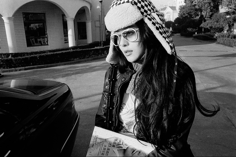Bingbing's beauty is arresting, touched by cold winter-morning sunlight while waiting outside her Shanghai villa for a chauffeured Mercedes.