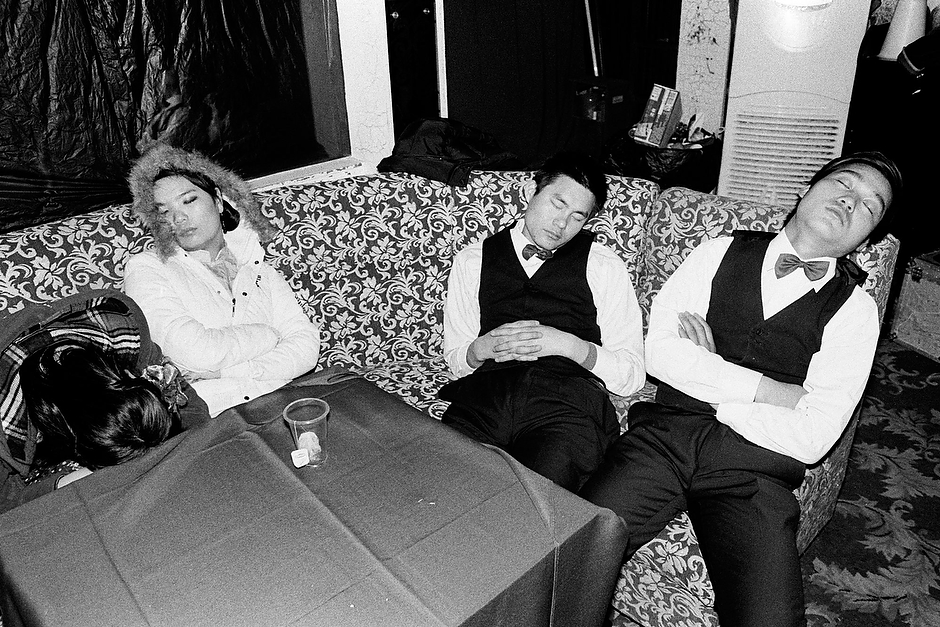 Exhausted and overworked teenage extras—most underpaid migrant workers —sleep between takes at an all-night shoot on location at a nightclub in central Shanghai.