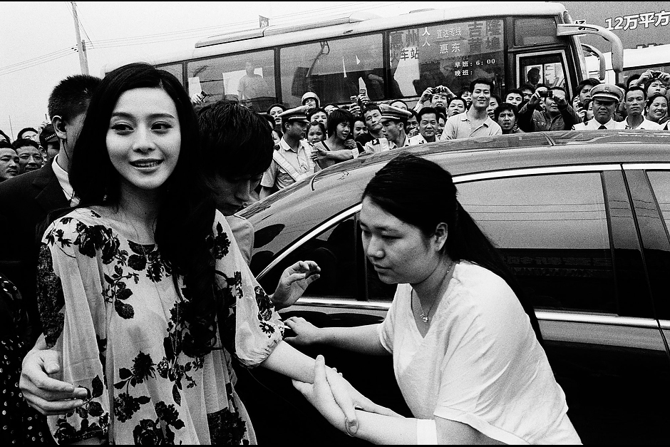 Assistants help Bingbing from her car outside an endorsement event for a women's shoe wholesaler in suburban Shenzhen.