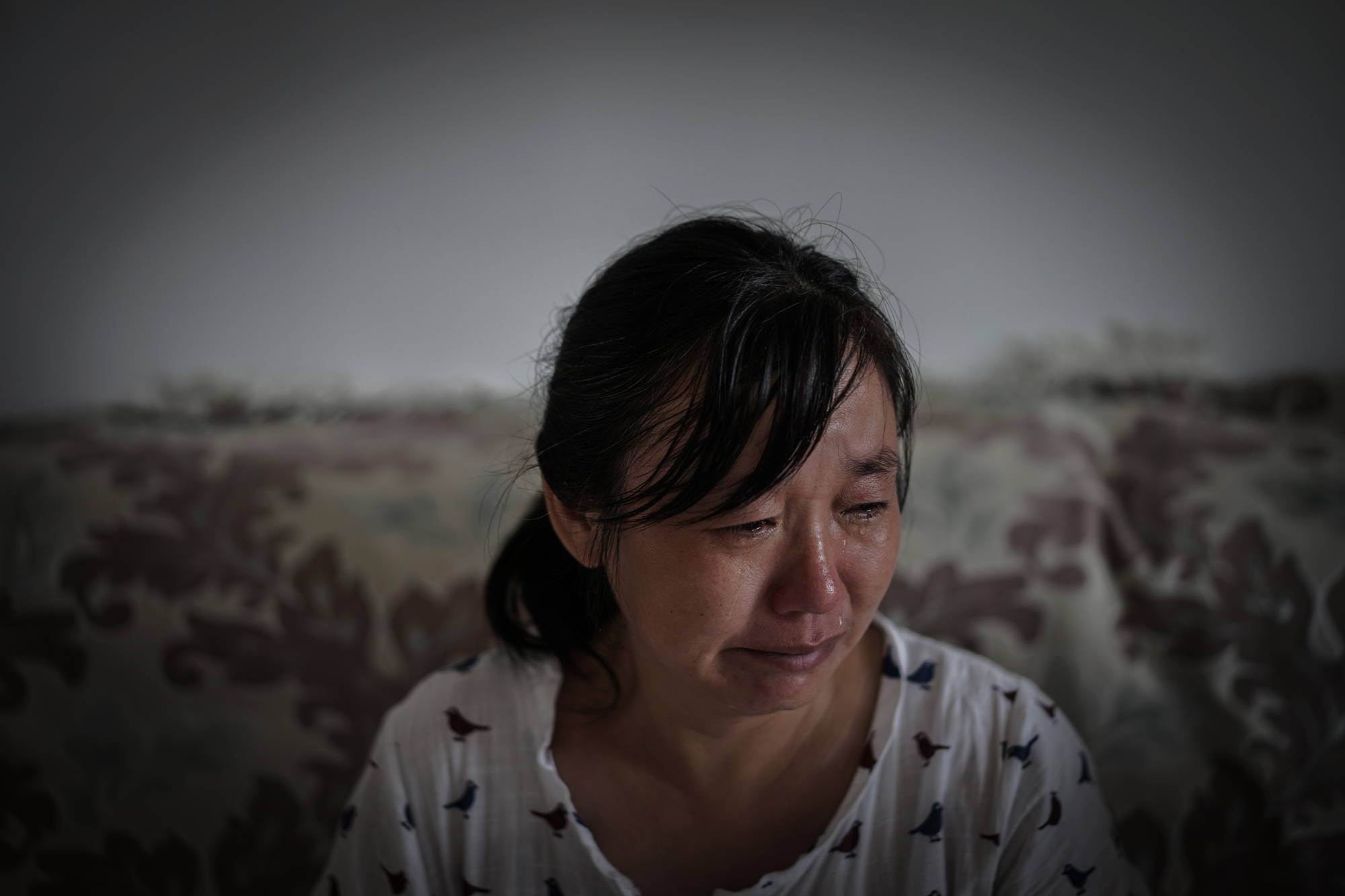 The anniversary of Ti's death is one of the most difficult times for his family.  Ti's mother, Fang Zhiying, talks about her son through tears at home in Suizhou, August 9, 2017.