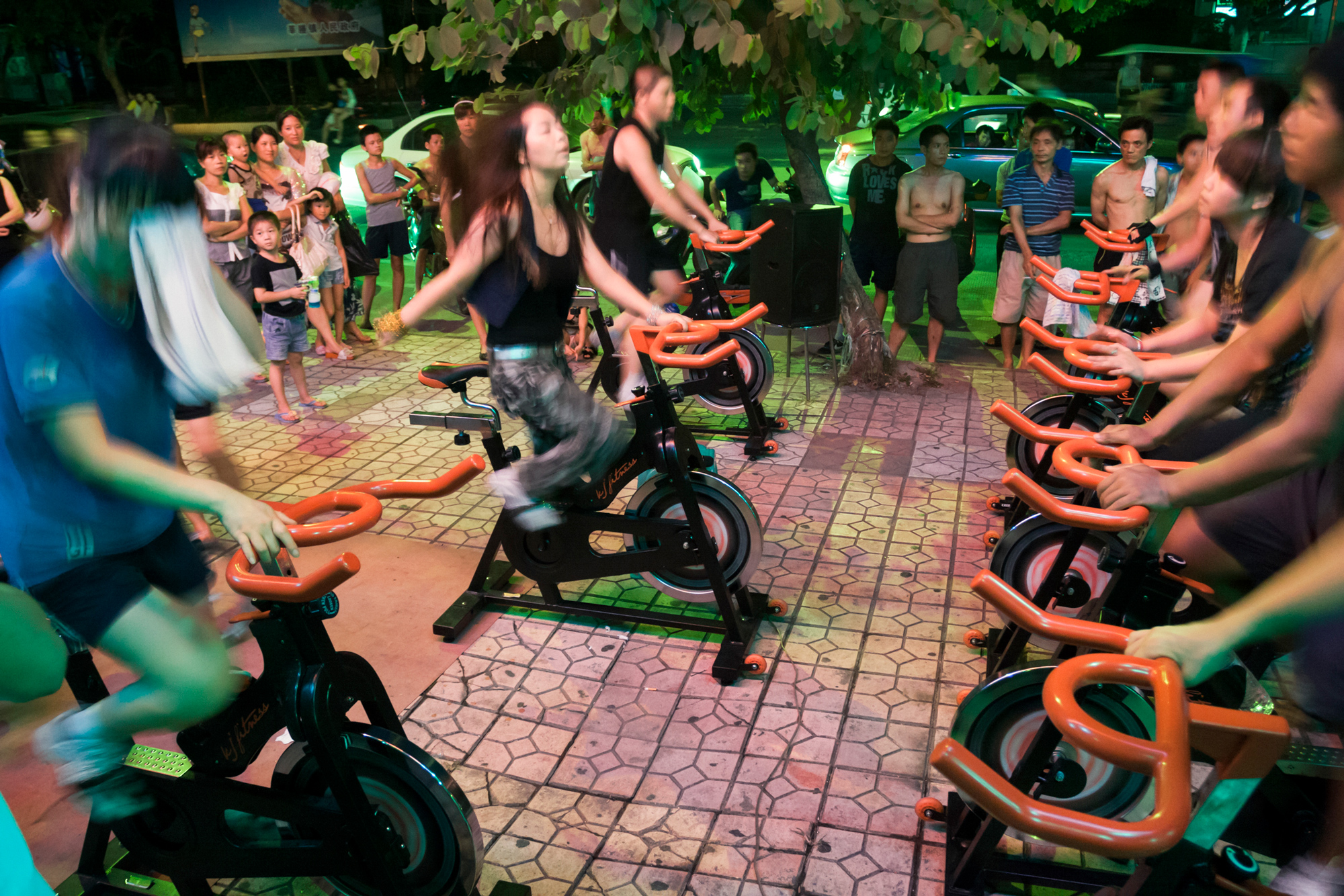 Young people work out at a public fitness facility in Shencheng sub-district, July 30, 2011.