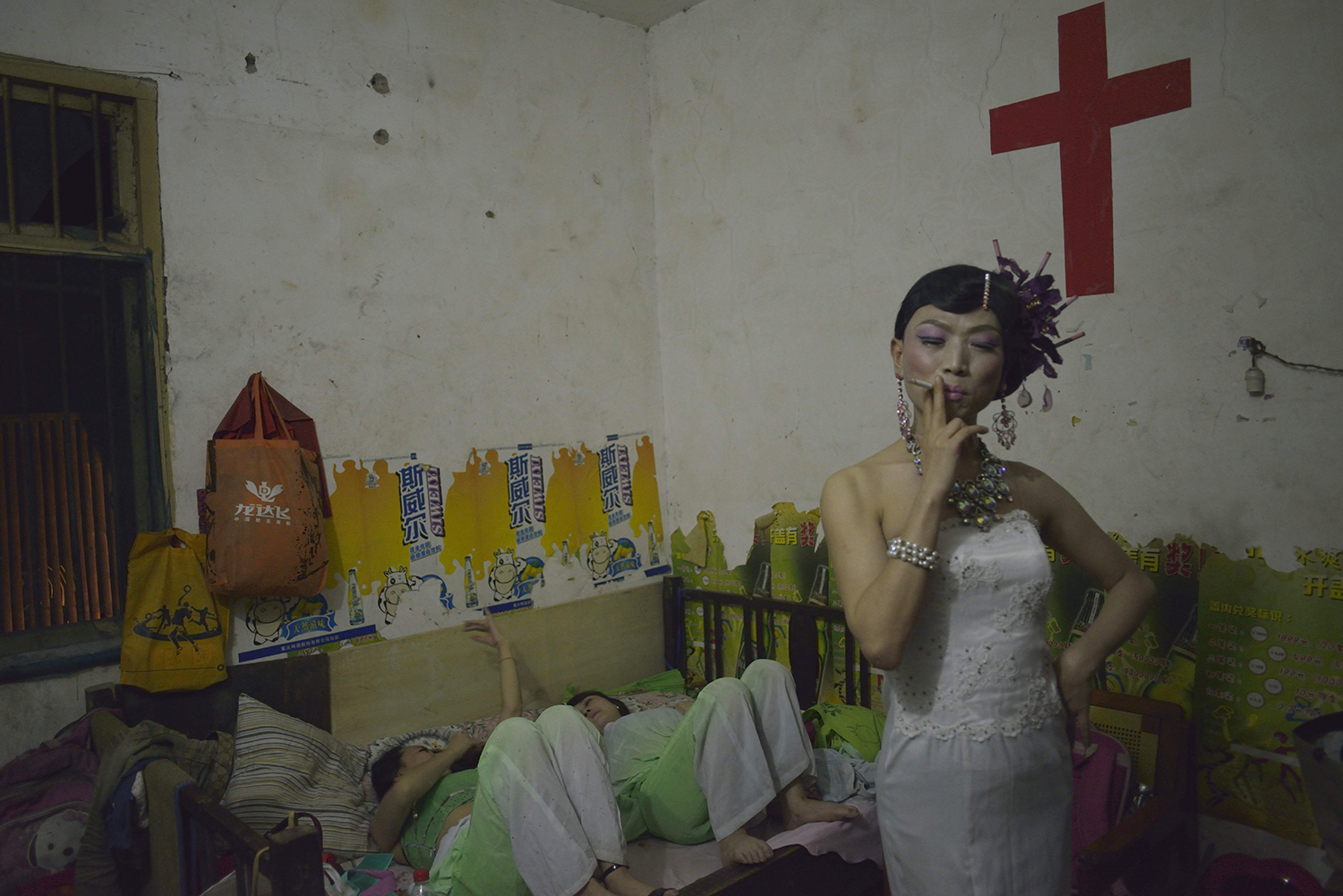 A performer smokes during a break at a funeral, Wanzhou district of Chongqing municipality, June 23, 2014.