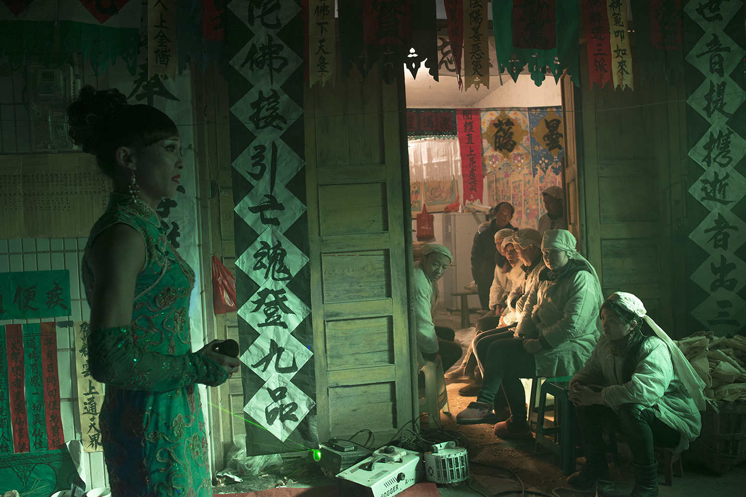 Family members of the departed watch Liangzi singing a song, December 23, 2014.