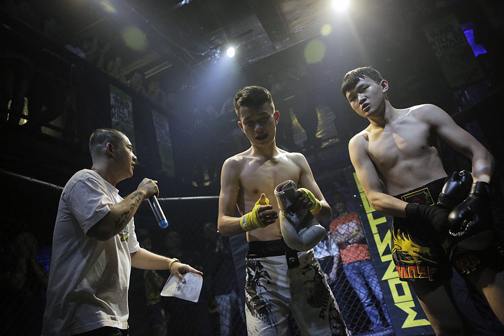 Xia (right), after winning the fight against Bo (center).