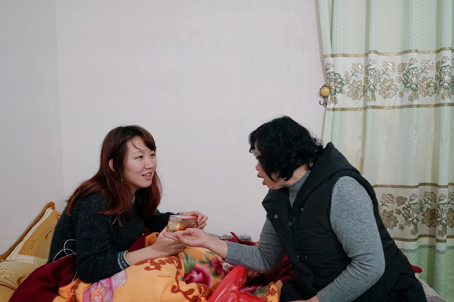January 29, the second day of the Lunar New Year, Nong Xiurong (right) gives a pack of tea leaves to Zhao Yuqing (left) as a gift before Zhao and Nong's son Wang Quanming end their visit, in Anxi, Fujian province. Wang hired Zhao to pose as his girlfriend so his family would stop pressuring him to find a wife. China's gender imbalance sometimes makes it difficult for men to find a partner. (Muyi Xiao/Reuters)