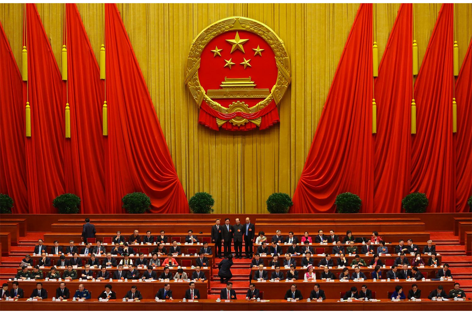 Deputies take a group photo on the rostrum inside the Great Hall of the People before the First Session of the 12th NPC begins, March 13, 2013. President Xi Jinping is seated in the first row, center.