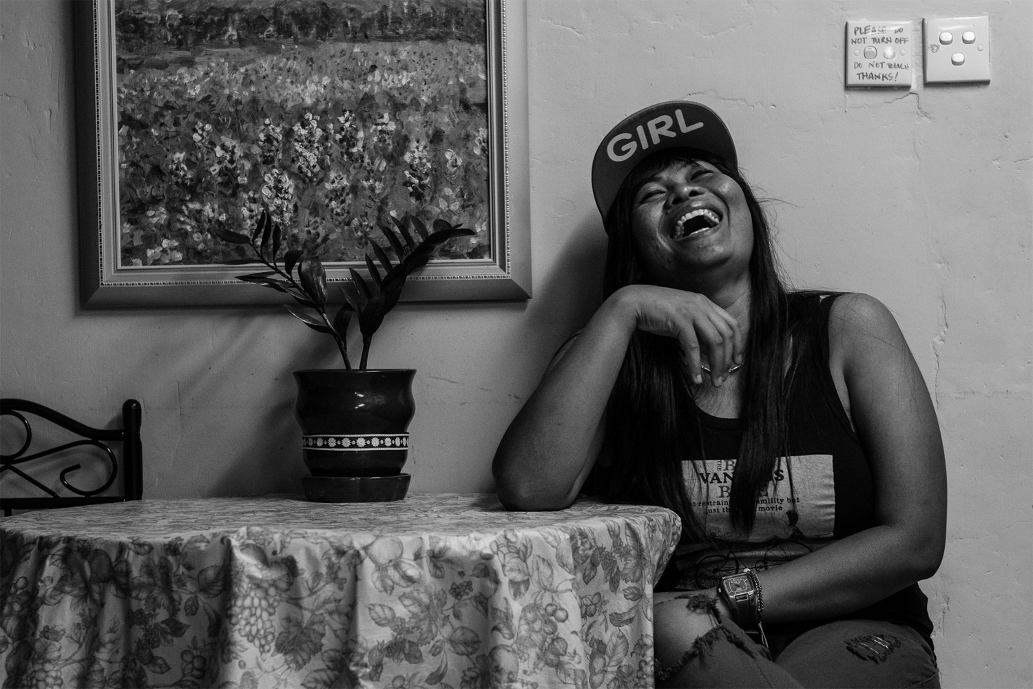 4. Minarsih, an Indonesian domestic worker, laughs during a Mother's Day celebration at the shelter. She has a six-year-old son in Indonesia. In 2014, Bethune House accommodated more than 600 migrant woman.
