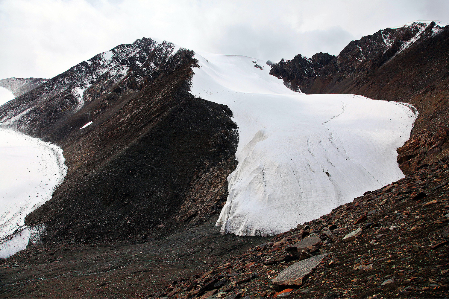 The retreating Tian Shan No. 1 Glacier has split in two. The glacier is a major source of water for the provincial capital of Urumqi. Photo by Yang Yong.