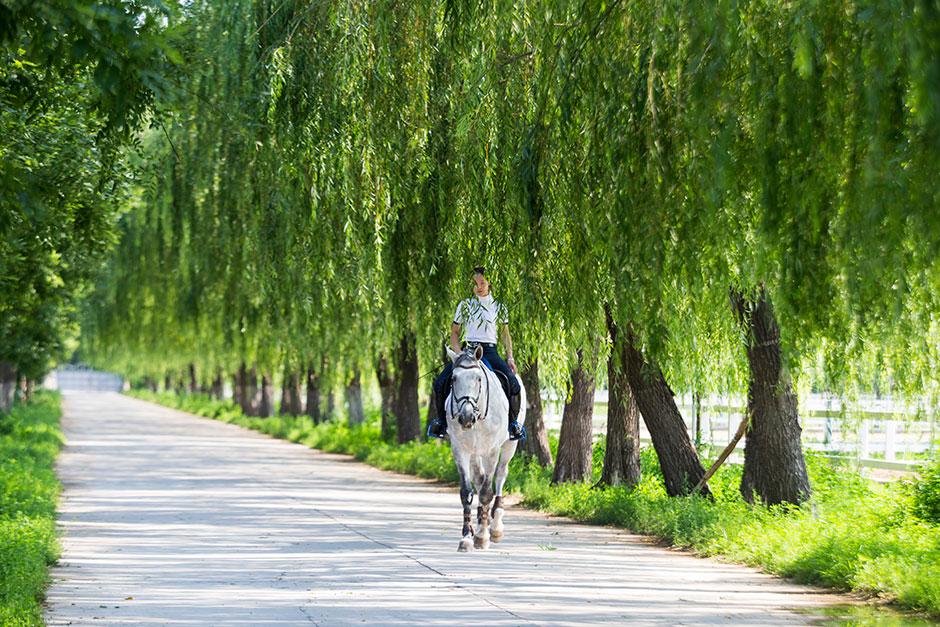 "Yu ""Vivi"" Tian, 19, rides outside Beijing's elite P.Y. Fulisilan Equestrian Club."