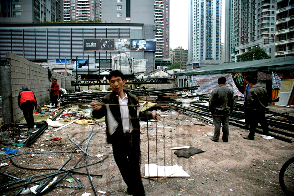In the late 1990s, Shenzhen embarked on plans for an ambitious new civic center and a central business district master plan. As the plan moved forward, Gangxia West Village was the last urban village left standing within the planning boundary of the Shenzhen Central Business District. Following demolition, workers would scour the area for recyclables and salvageable materials.