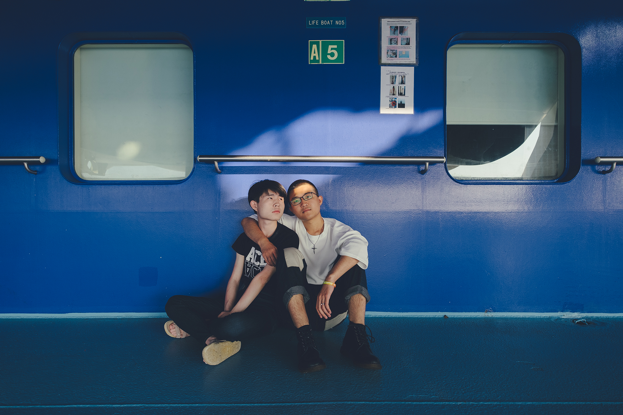 "Wang Yunshen and Hu Hu are another couple who wed on the cruise. Wang is 22 and Hu Hu is 19. The legal age of marriage for men in China is 22. They met last year. ""It is important for LGBTQ people to come out of the closet because self-identity matters,"" said Wang. None of their parents are on board."