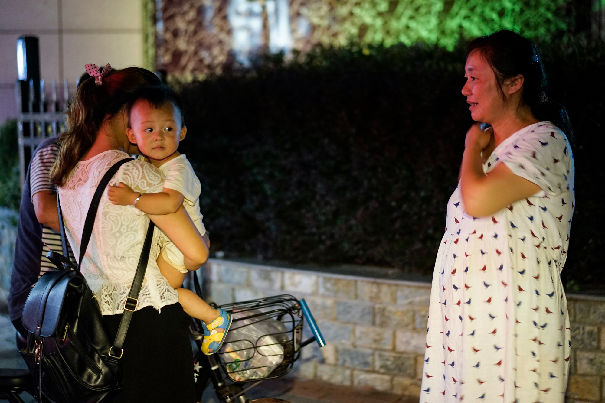 Zhiying and her nephew's wife chat about pregnancy and birth in Suizhou, August 9, 2017.