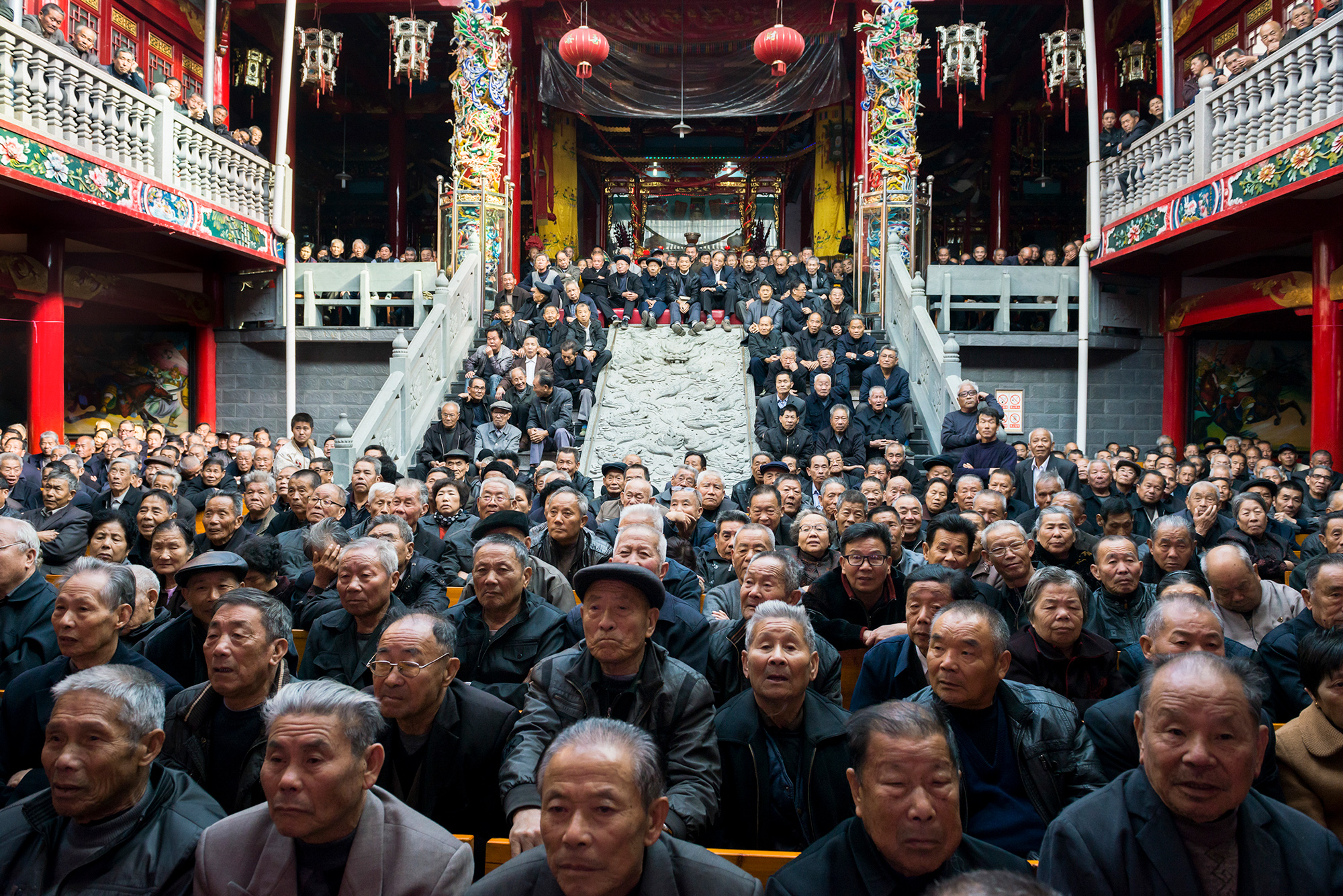 Elderly audience members watch Chinese opera at an ancestral shrine in Tingtian sub-district, November 25, 2013.