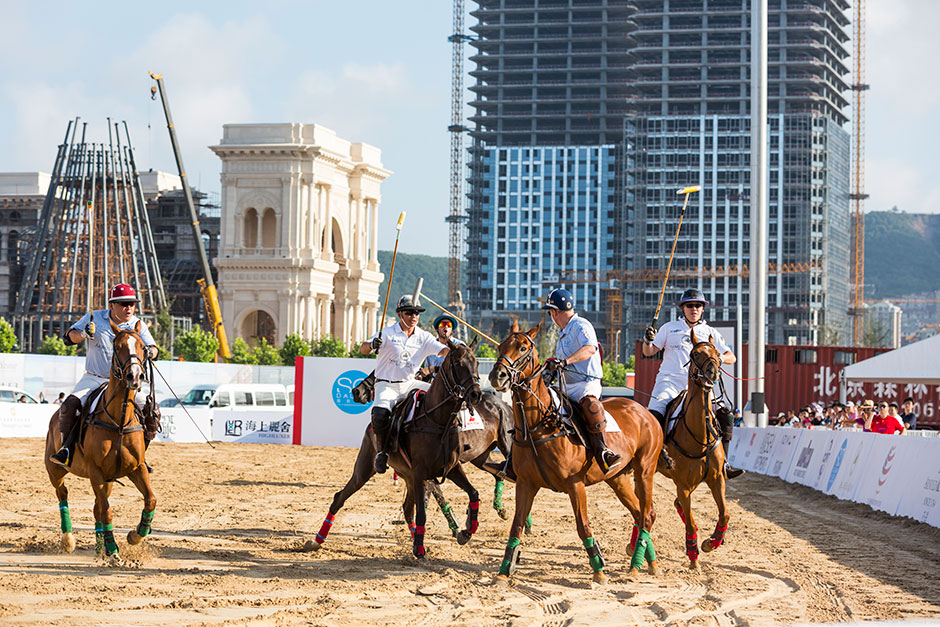 "A match is underway at the ""beach polo"" event put on by SO! Dalian."