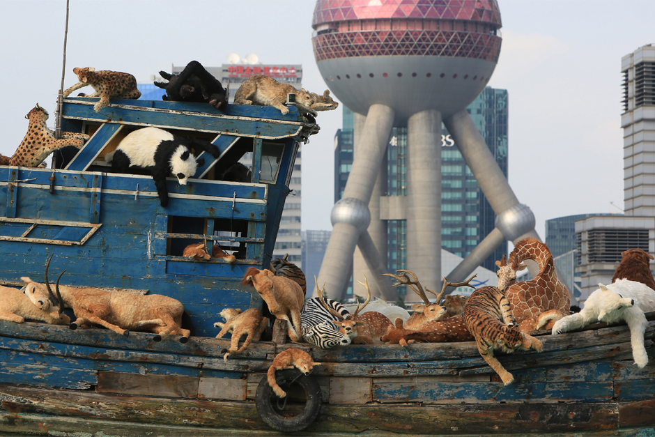 "The installation ""The Ninth Wave"" sails down the Huangpu River, July 17, 2014 in Shanghai. The installation, which consists of an old fishing vessel loaded with stuffed toy animals, is inspired by last year's incident in which 16,000 dead pigs were found floating down the Huangpu River. (ChinaFotoPress photo)"