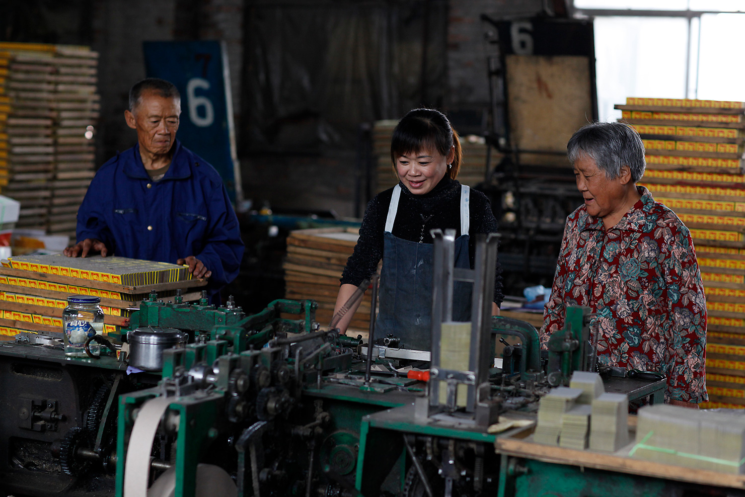 Lu's daughter, Lu Ying, center, works at the factory as a machine operator.